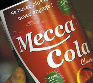 BOTTLE OF MECCA COLA IS HELD BY BUSINESSMAN MATHLOUTHI NEAR PARIS